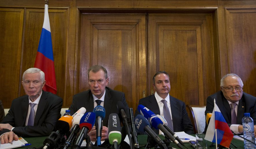 Russia's ambassador Alexander Shulgin, center left, Deputy Minister of Industry and Trade Georgy Kalamanov, center right, and defense ministry experts Igor Rybalchenko, right, and Viktor Kholstov, left, address the media during a press conference at the Russian embassy in The Hague, Netherlands, Wednesday, April 4, 2018, following a special executive council of the Organisation for the Prohibition of Chemical Weapons (OPCW) which discussed the nerve agent attack on a former Russian spy and his daughter last month. (AP Photo/Peter Dejong)