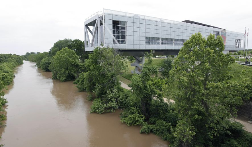 FILE - This Wednesday, May 13, 2015 file photo shows the Clinton Presidential Library in Little Rock, Ark. On Wednesday, April 4, 2018, The Associated Press has found that stories circulating on the internet that two deputies were killed in Arkansas on their way to the Clinton Presidential Library to deliver a search warrant are untrue. (AP Photo/Danny Johnston)