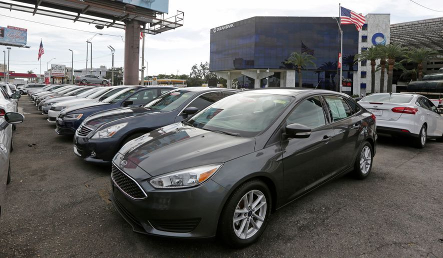 FILE- In this Jan. 17, 2017, file photo, certified pre-owned vehicles sit on display at an auto dealership in Miami. Used vehicle sales hit 39.2 million vehicles in 2017, more than double the number of new automobiles sold, according to the Edmunds.com auto website. (AP Photo/Alan Diaz, File)