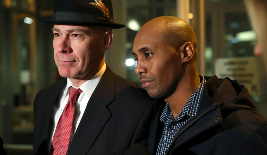 FILE - In this March 21, 2018, file photo, former Minneapolis Police Officer Mohamed Noor leaves the Hennepin County Public Safety Facility with his attorney, Thomas Plunkett, left, after posting bail in Minneapolis. Noor is charged with murder and manslaughter in the July death of Justine Ruszczyk Damond, who had called 911 to report a possible sexual assault behind her home. Police in Minneapolis announced Wednesday, April 4, 2018, new steps to make sure officers use body cameras in the wake of last summer's fatal shooting. (Jeff Wheeler/Star Tribune via AP, File)