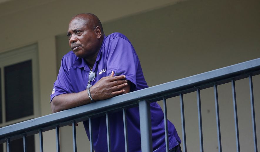 FILE - In this July 28, 2017, file photo, Baltimore Ravens general manager and executive vice president Ozzie Newsome looks out over practice fields following an NFL football training camp practice, in Owings Mills, Md. Perhaps there will come a time when Ozzie Newsome looks back wistfully on his final NFL draft with the Baltimore Ravens. For now, the only general manager in Ravens history is focused on getting the team into the playoffs in what will be his last year on the job. (AP Photo/Patrick Semansky, File)