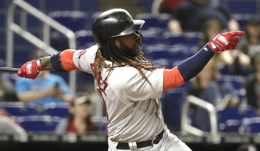 Boston Red Sox's Hanley Ramirez follows through on a RBI double to score Mookie Betts and Andrew Benintendi in the thirteenth inning of a baseball game against the Miami Marlins, Tuesday, April 3, 2018, in Miami. The Red Sox defeated the Marlins 4-2 in thirteen innings. (AP Photo/Lynne Sladky)