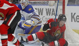 Buffalo Sabres goalie Chad Johnson (31) looks for the puck as Ottawa Senators forward Mike Hoffman (68) collides with the goal during the second period of an NHL hockey game Wednesday, April 4, 2018, in Buffalo, N.Y. (AP Photo/Jeffrey T. Barnes)