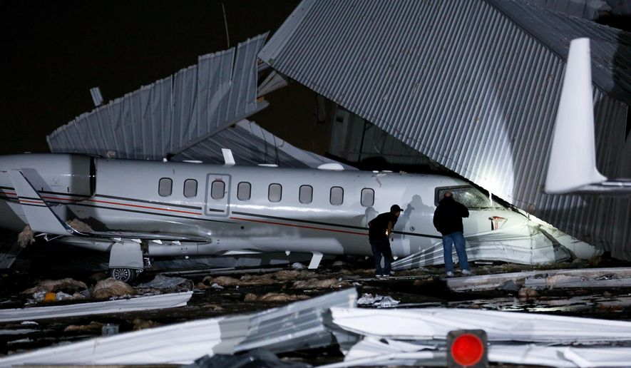 High winds damaged an airplane hangar at William P. Hobby Airport Wednesday, April 4, 2018, in Houston.  The National Weather Service says gusts of about 60 mph (100 kph) were recorded late Tuesday at the airport. Authorities say the wind appears to have caused the hangar at a private terminal to disintegrate. An airport spokesman, Bill Begley, says the collapse caused millions of dollars of damage. There have been no reports of injuries (Godofredo A. Vasquez /Houston Chronicle via AP)