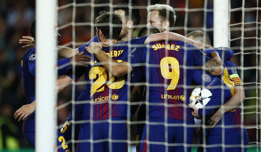 Barcelona's players celebrates the opening goal of their team against Roma during a Champions League quarter-final, first leg soccer match between FC Barcelona and Roma at the Camp Nou stadium in Barcelona, Spain, Wednesday, April 4, 2018.(AP Photo/ Manu Fernandez)
