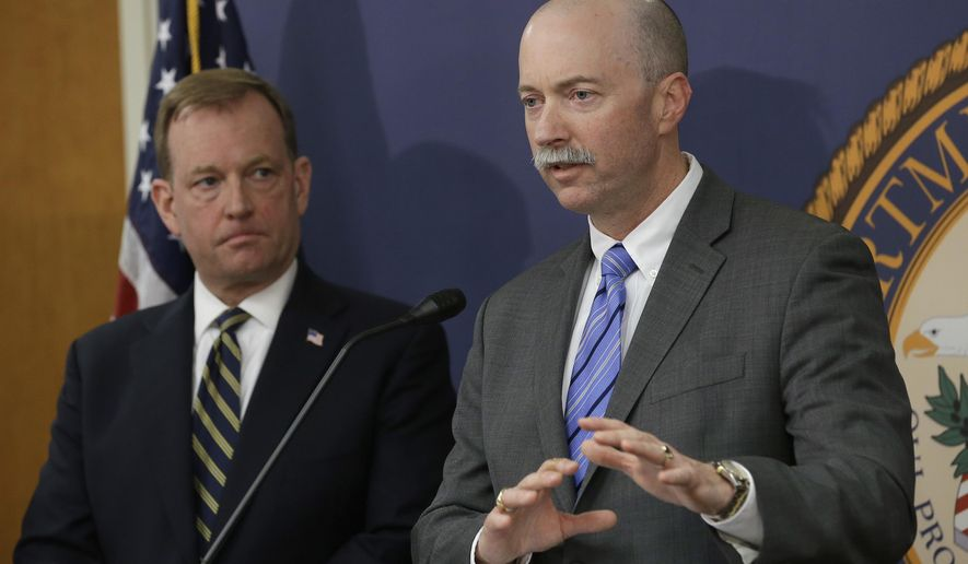 FBI Special Agent in Charge Sean Ragan, right, flanked by McGregor Scott, the United States Attorney For the Eastern District of California, discusses the months-long investigation that led to the law enforcement raids on illegal pot grows in roughly 100 Northern California homes, during a news conference, Wednesday, April 4, 2018, in Sacramento, Calif. The raids, conducted Tuesday and Wednesday in multiple counties, focused on homes purchased with money wired to the United States by a Chinese-based crime organization and used to grow massive amounts of marijuana. (AP Photo/Rich Pedroncelli)