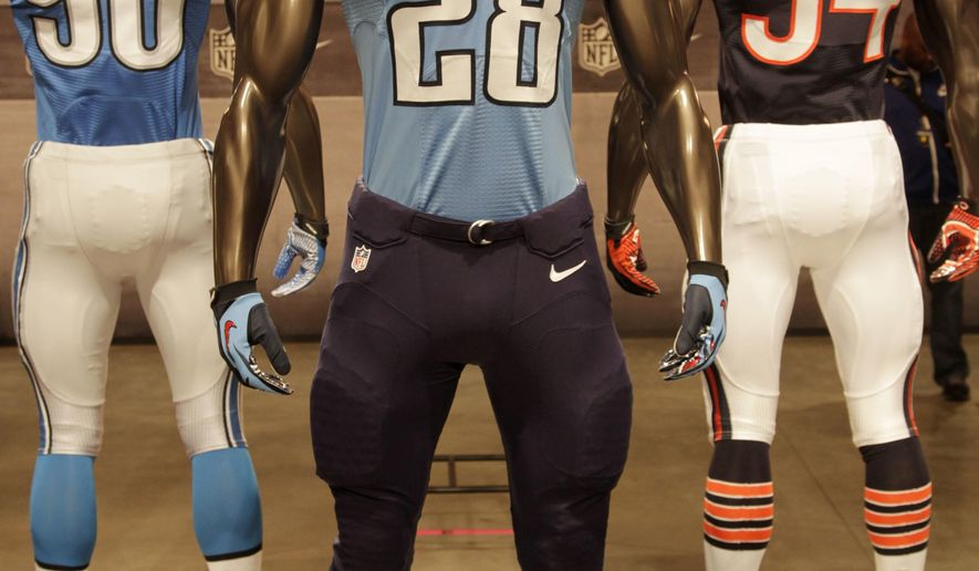 FILE - In this April 3, 2012 file photo, a Tennessee Titans uniform is displayed on a mannequin in New York. The Titans are unveiling the first major redesign of their uniforms in two decades Wednesday night, April 4, 2018. (AP Photo/Seth Wenig, File)