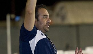 FILE - In this Sept. 23, 2013, file photo, Bahram Hojreh coaches youngsters at at the USA Water Polo National Training Center in Los Alamitos, Calif. Hojreh, who ran a club affiliated with USA Water Polo, has been charged with the sexual abuse of seven underage female players during one-on-one coaching sessions, prosecutors said Wednesday, April 4, 2018. The victims were underage female water polo players and the alleged crimes occurred between 2014 and January of this year, the Orange County district attorney's office said. (Rose Palmisano/The Orange County Register via AP)