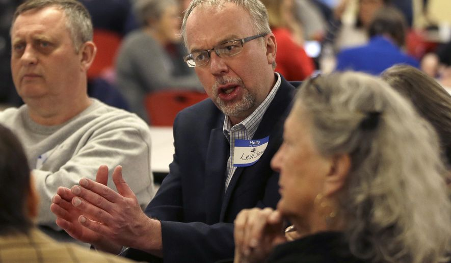 Levi Sanders, candidate for U.S. Congress, speaks to potential voters at a candidates' forum, Thursday, April 5, 2018, in Rochester, N.H. Voters are getting their first chance to hear from the son of Bernie Sanders, who is making a run for Congress in New Hampshire. (AP Photo/Elise Amendola)