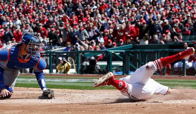Washington Nationals outfielder Adam Eaton tweaked his ankle on a slide past New York Mets catcher Kevin Plawecki in the third inning.