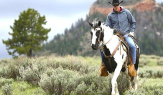 Hands-on official: Interior Secretary Ryan Zinke takes a horseback ride through the Bears Ears National Monument in Utah. (Associated Press)