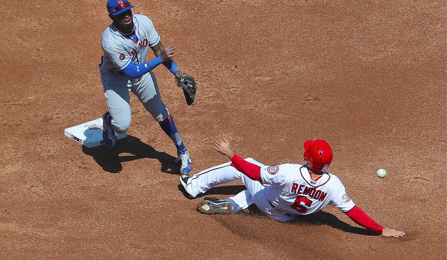 Washington Nationals third baseman Anthony Rendon is out at second base on a double play on Thursday. Rendon had three hits in the home-opening loss. (ASSOCIATED PRESS) ** FILE **