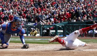 New York Mets catcher Kevin Plawecki (26) can't make the tag on Washington Nationals' Adam Eaton (2) as he scores during the third inning of the home opener baseball game at Nationals Park, Thursday, April 5, 2018, in Washington. (AP Photo/Alex Brandon)