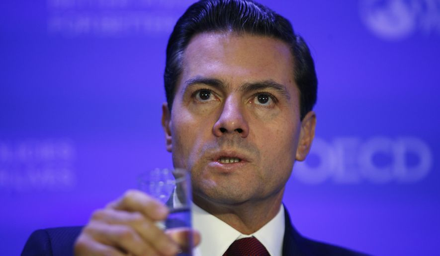 """""""If your recent statements are the result of frustration due to domestic policy issues, to your laws or to your Congress, it is to them that you should turn to, not to Mexicans,"""" Mexican President Enrique Pena Nieto said in Spanish, which was translated by the Mexican government. (Associated Press)"""