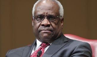 Supreme Court Associate Justice Clarence Thomas sits as he is introduced during an event at the Library of Congress, Thursday, Feb. 15, 2018, in Washington. (AP Photo/Pablo Martinez Monsivais)