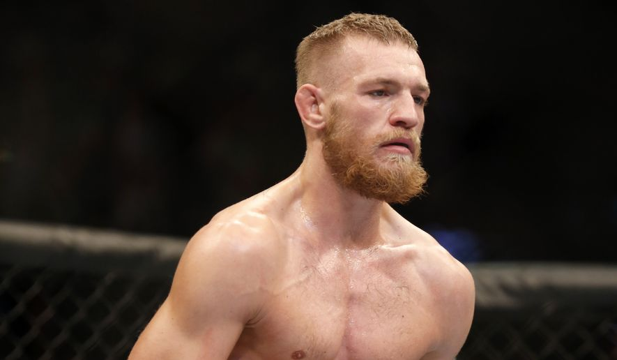 Conor McGregor, of Ireland, is seen against Max Holloway in their UFC on Fox Sports 1 mixed martial arts bout in Boston, Saturday, August 17,2013. McGregor won via unanimous decision. (AP Photo/Gregory Payan)
