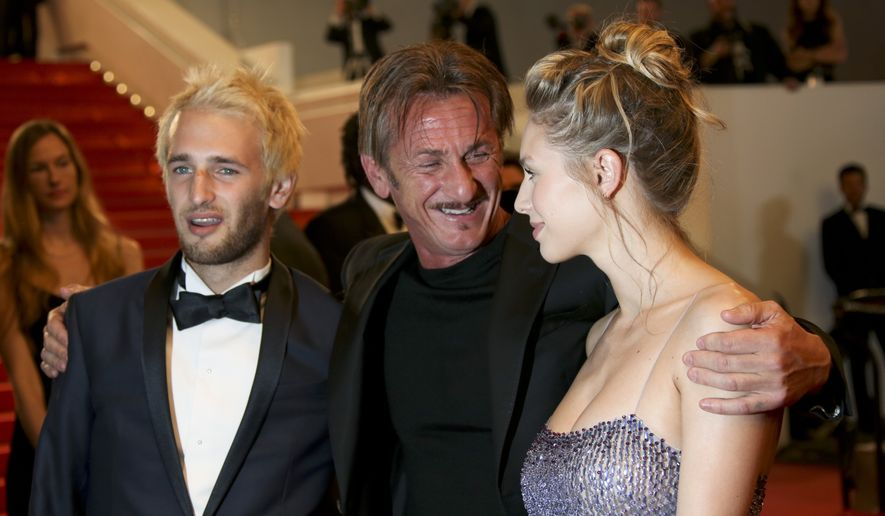 Hopper Penn, director Sean Penn and Dylan Penn from left, pose for photographers upon arrival at the screening of the film The Neon Demon at the 69th international film festival, Cannes, southern France, Friday, May 20, 2016. (AP Photo/Joel Ryan)