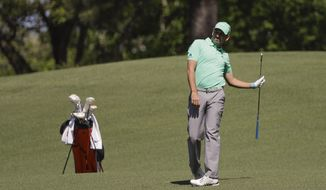 Sergio Garcia, of Spain, watches his shot on the second hole during the first round at the Masters golf tournament Thursday, April 5, 2018, in Augusta, Ga. (AP Photo/David J. Phillip) ** FILE **