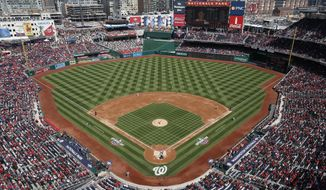 Washington Nationals starting pitcher Stephen Strasburg (37) throws against the New York Mets during the first inning of home opener baseball game, at Nationals Park, Thursday, April 5, 2018 in Washington. (AP Photo/Pablo Martinez Monsivais)
