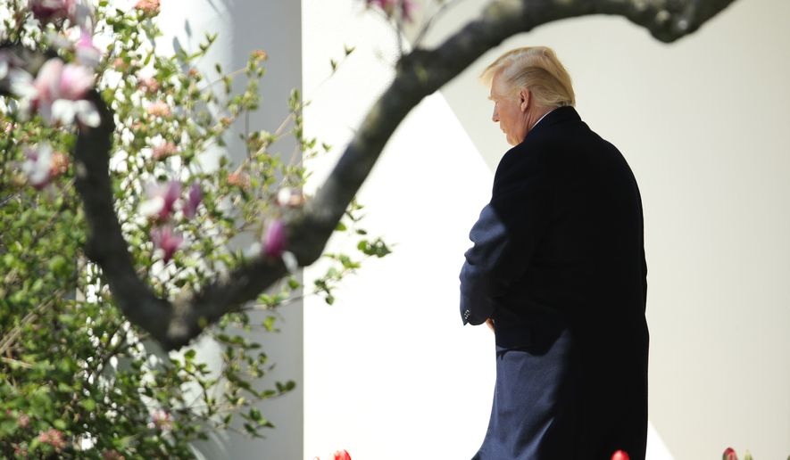 President Donald Trump walks along the Colonnade to board Marine One as he leaves the White House, Thursday, April 5, 2018 in Washington. Trump is traveling to West Virginia to hold a discussion on taxes in White Sulphur Springs. (AP Photo/Manuel Balce Ceneta)