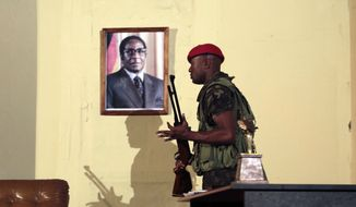 In this photo taken on Wednesday, March, 28, 2018, a portrait of former Zimbabwean President Robert Mugabe is seen during a play dramatizing the events leading to Mugabe's resignation, in Harare. Laughter has replaced fear as the events leading to Mugabe's resignation in November are already playing out on stage. Crowds packed a theater in the capital as Mugabe and his wife were openly mocked in scenes that would have led to arrests during his 37 years in power. (AP Photo/Tsvangirayi Mukwazhi)