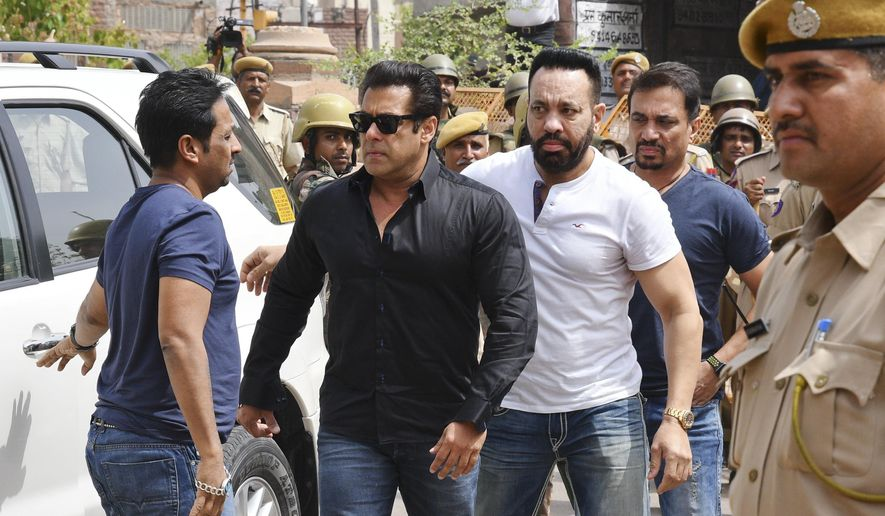 Bollywood star Salman Khan, second left, arrives to appear before a court in Jodhpur, Rajasthan state, India, Thursday, April 5, 2018. Khan was convicted Thursday of poaching rare deer in a wildlife preserve two decades ago and could face up to six years in prison. (AP Photo/Sunil Verma)