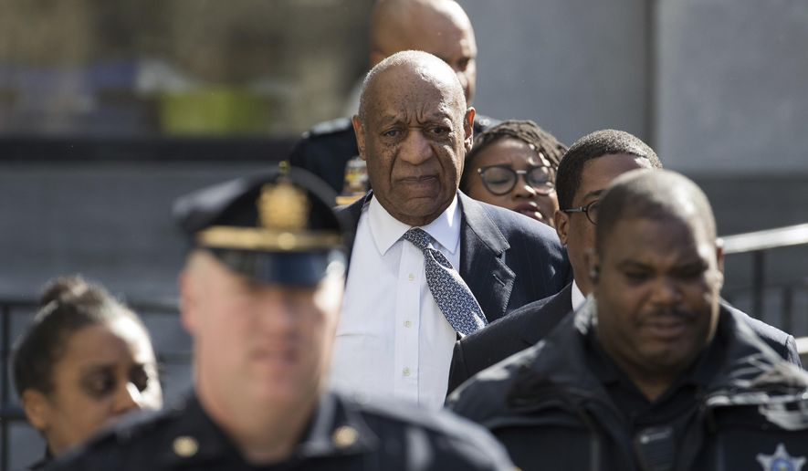 Bill Cosby leaves the Montgomery County Courthouse after jury selection for his sexual assault retrial, Wednesday, April 4, 2018, in Norristown, Pa. Prosecutors and the defense have settled on the panel of 12 jurors who will sit in judgment of the 80-year-old comedian. They still have to pick six alternates. (AP Photo/Chris Szagola)