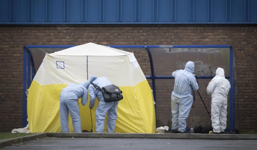 Forensic officers at the scene where a 16-year old boy was shot on Monday evening and left in a critical condition outside the leisure centre in Walthamstow, east London, Tuesday April 3, 2018.  A 17-year old girl was shot and died on Monday evening, in the nearby Tottenham district of north London. The homicide rate in London has increased each month in 2018 as the British capital experiences a rise in violent crime. (Jonathan Brady/PA via AP)