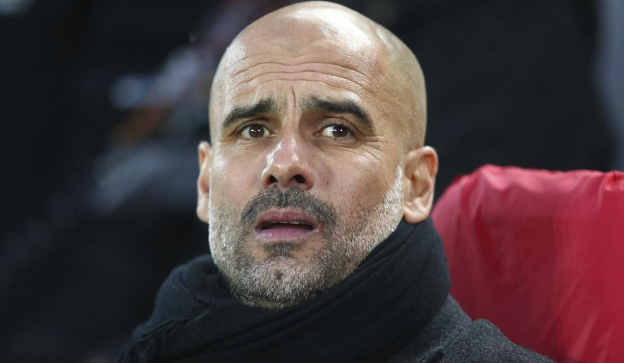 Manchester City coach Josep Guardiola ahead of the Champions League quarter final first leg soccer match between Liverpool and Manchester City at Anfield stadium in Liverpool, England, Wednesday, April 4, 2018. (AP Photo/Dave Thompson)