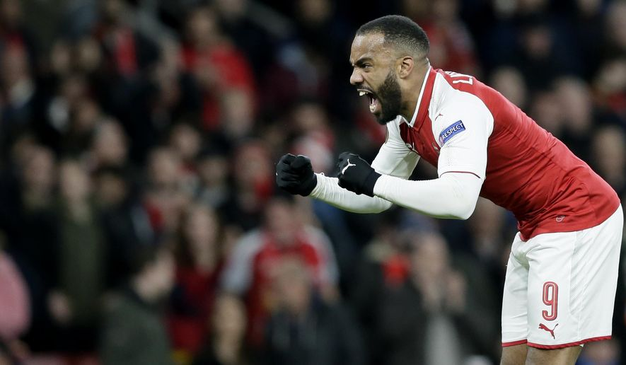 Arsenal's Alexandre Lacazette celebrates after scoring a goal during the Europa League quarterfinal, first leg soccer match between Arsenal and CSKA Moscow at the Emirates stadium in London Thursday, April 5, 2018. (AP Photo/Tim Ireland)