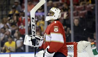 Florida Panthers goaltender Roberto Luongo acknowledges the crowd as he is recognized for playing in his 1,000th career NHL hockey game during the first period against the Boston Bruins, Thursday, April 5, 2018, in Sunrise, Fla. (AP Photo/Lynne Sladky)