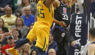 Utah Jazz guard Donovan Mitchell (45) goes to the basket as Los Angeles Clippers forward Wesley Johnson (33) defends in the first half during an NBA basketball game Thursday, April 5, 2018, in Salt Lake City. (AP Photo/Rick Bowmer)