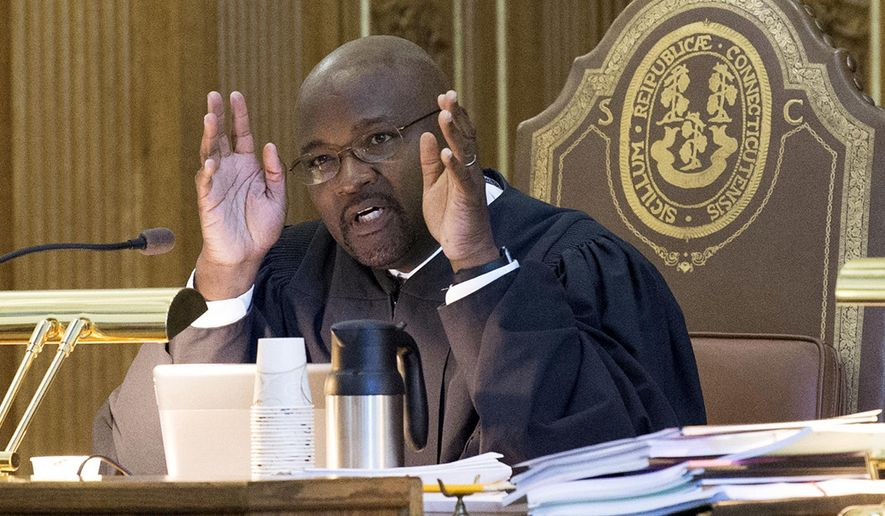 FILE - In this Sept. 28, 2017 file photo, Associate Justice Richard A. Robinson questions an attorney during a session at Connecticut Supreme Court in Hartford, Conn. Gov. Dannel P. Malloy announced Thursday, April 5, 2018, he is nominating Robinson for chief justice. Malloy's previous chief justice nominee, Associate Justice Andrew McDonald, was rejected the previous week by the state Senate in a mostly party-line vote. If confirmed, Robinson would succeed Chase Rogers, who retired in February. (Patrick Raycraft/The Courant via AP, File)
