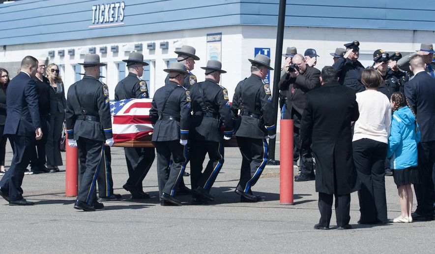 CORRECTS TO WAKE, NOT FUNERAL SERVICE - Connecticut State Troopers carry the casket of Trooper Kevin Miller into Rentschler Field for a wake, Thursday, April 5, 2018, in East Hartford, Conn. The 49-year-old Miller died while on duty March 29 when his cruiser rear-ended a tractor-trailer on Interstate 84 eastbound in Tolland. The cause of the crash remains under investigation. His funeral will be held Friday morning at Rentschler Field. (Peter Casolino/Hartford Courant via AP)