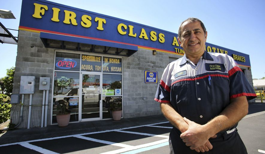 In this Friday, March 23, 2018 photo, automotive shop owner Nabil Armaly poses in front of his store in Orlando,Fl a. Amaly has owned the business for 15 years. (Joe Burbank/Orlando Sentinel via AP)