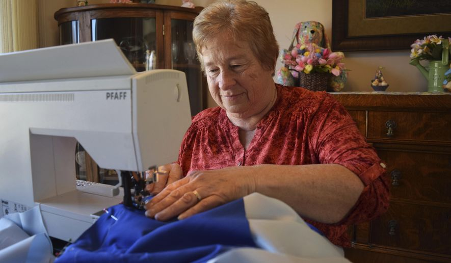 In this March 23, 2018, Elaine Hilmer, who has been designing costumes for Kids Fun and Drama for nearly 30 years, sews in Beloit, Wis. She's now a member of the youth theatre troupe's board, and loves to support the organization however she can. (Erica Pennington/The Beloit Daily News via AP)