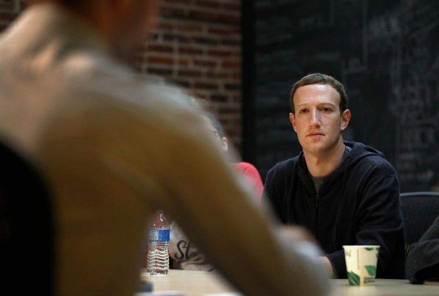 FILE- In this Nov. 9, 2017, file photo, Facebook CEO Mark Zuckerberg meets with a group of entrepreneurs and innovators during a round-table discussion at Cortex Innovation Community technology hub in St. Louis. Zuckerberg will testify before Congress next week as authorities investigate allegations that the political data-mining firm Cambridge Analytica inappropriately accessed data on millions of Facebook users to influence elections. (AP Photo/Jeff Roberson, File)