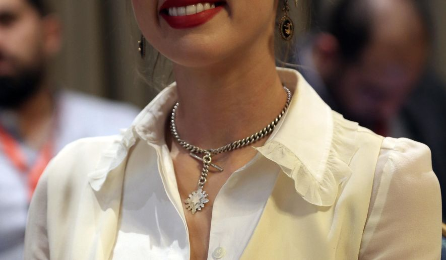 """American actress Amber Heard smiles after meeting with Syrian refugees and medical volunteers in Amman, Jordan, Thursday, April 5, 2018. Heard, 31, said the experience has left an """"indelible mark"""" on her. (AP Photo/Raad Adayleh)"""
