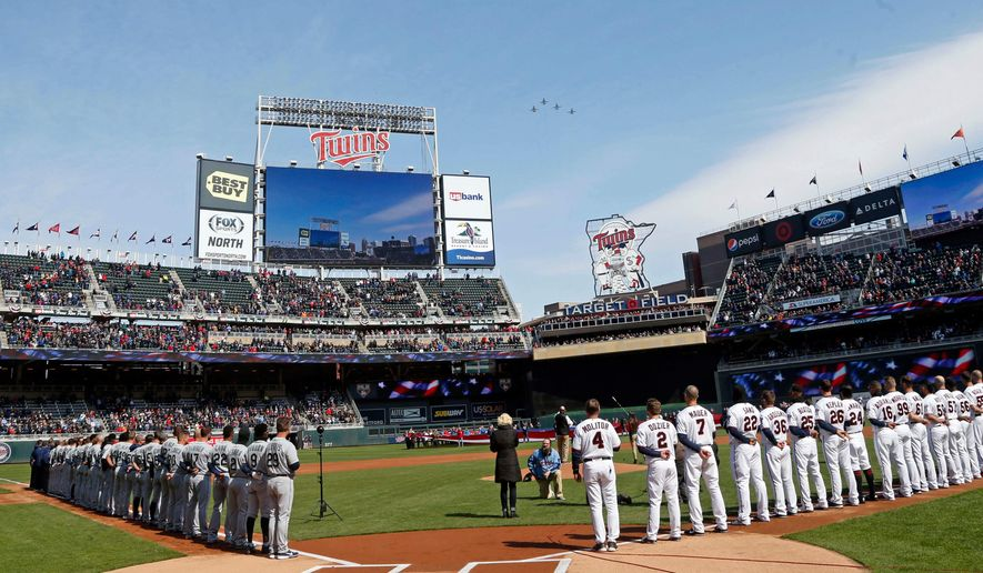 A flyover of four Air Force jets comes over Target Field after the national anthem as the Seattle Mariners and the Minnesota Twins line up prior to the Twins home-opener baseball game Thursday, April 5, 2018, in Minneapolis. (AP Photo/Jim Mone)