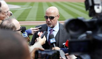 Washington Nationals general manager Mike Rizzo speaks during a media availability before the home opener baseball game against the New York Mets at Nationals Park, Thursday, April 5, 2018, in Washington. (AP Photo/Alex Brandon)