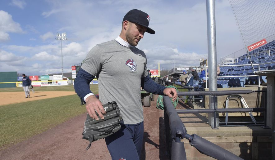 New York Mets outfielder Tim Tebow steps into the dugout before his debut with the Binghamton Rumble Ponies minor league baseball team as they host the Portland Sea Dogs, Thursday, April 5, 2018, at NYSEG Stadium in Binghamton, N.Y. (AP Photo/Matt Smith)