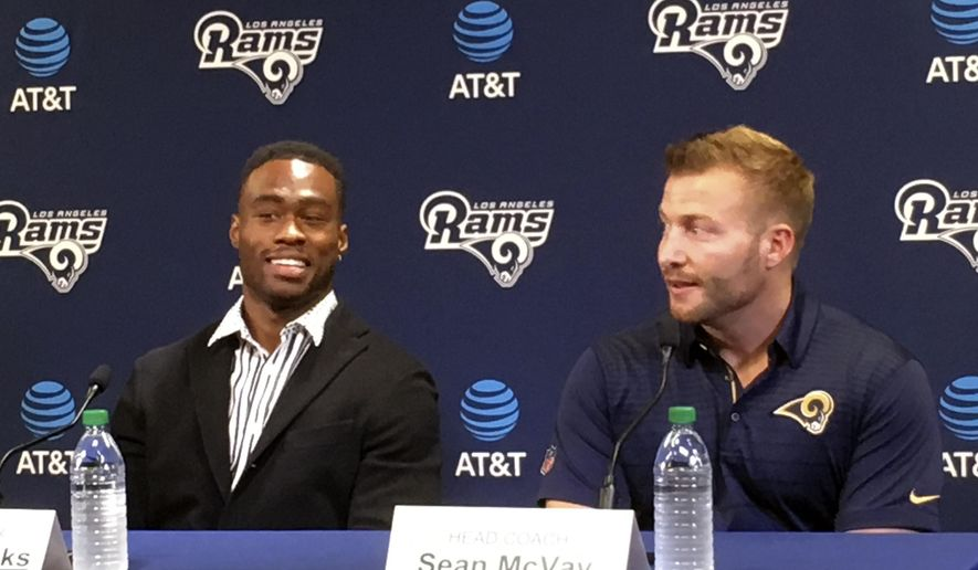 Los Angeles Rams' Brandin Cooks, left, talks during a news conference with head coach Sean McVay at the team's practice facility in Thousand Oaks, Calif., Thursday, April 5, 2018. Cooks was one of the NFL's best receivers the last three seasons. (AP Photo/Greg Beacham)