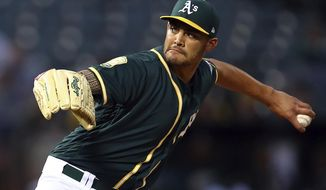 Oakland Athletics pitcher Sean Manaea works against the Texas Rangers during the first inning of a baseball game Wednesday, April 4, 2018, in Oakland, Calif. (AP Photo/Ben Margot)