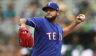 Texas Rangers pitcher Martin Perez works against the Oakland Athletics during the first inning of a baseball game Thursday, April 5, 2018, in Oakland, Calif. (AP Photo/Ben Margot)