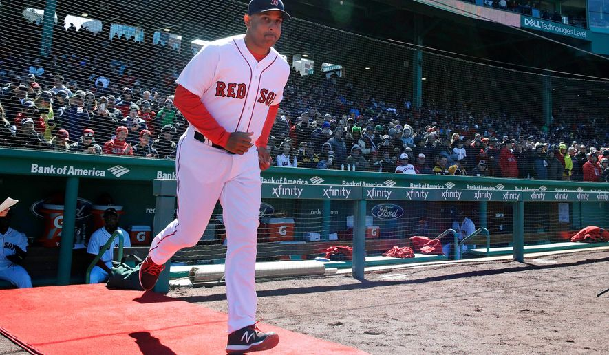 Boston Red Sox manager Alex Cora (20) runs onto the field as he is introduced during ceremonies prior to a home opener baseball game against the Tampa Bay Rays at Fenway Park in Boston, Thursday, April 5, 2018. (AP Photo/Charles Krupa)