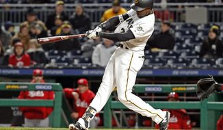 Pittsburgh Pirates' Gregory Polanco hits a two-run home run off Cincinnati Reds starting pitcher Homer Bailey during the fifth inning of a baseball game in Pittsburgh, Thursday, April 5, 2018. (AP Photo/Gene J. Puskar)