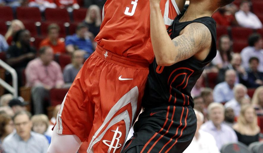 Houston Rockets guard Chris Paul (3) collides with Portland Trail Blazers guard Shabazz Napier (6) on a shot-attempt during the first half of an NBA basketball game Thursday, April 5, 2018, in Houston. (AP Photo/Michael Wyke)