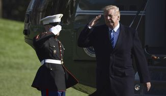 President Donald Trump salutes as he walks off of Marine One on the South Lawn of the White House in Washington, Thursday, April 5, 2018, after returning from a trip to West Virginia. (AP Photo/Susan Walsh)