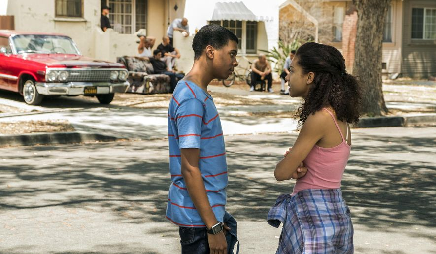 "This image released by Netflix shows Brett Gray, left, and Sierra Capri in a scene from ""On My Block."" The new teen dramedy attempts to tackle race and poverty with John Hughes 1980s-style humor. Set in a fictional working-class Latino and black Southern California neighborhood, teens work through typical issues of love and acceptance despite the gang violence and constant police presence. (John O Flexor/Netflix via AP)"