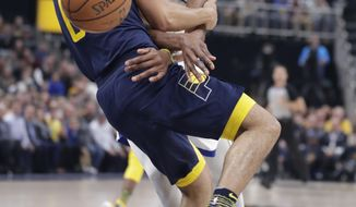 Golden State Warriors forward Kevin Durant (35) loses the ball as he fouled by Indiana Pacers guard Cory Joseph (6) during the first half of an NBA basketball game in Indianapolis, Thursday, April 5, 2018. (AP Photo/Michael Conroy)